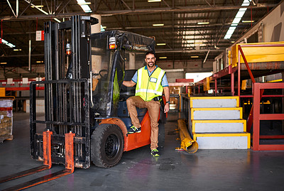Buy stock photo Portrait of smiling forklift operator in a large warehouse
