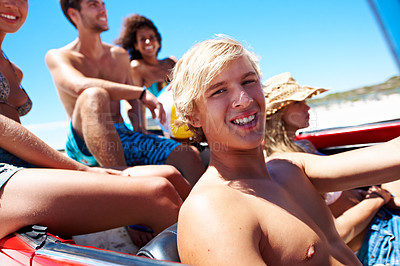 Buy stock photo Portrait of a handsome young man on a road trip to the beach with friends