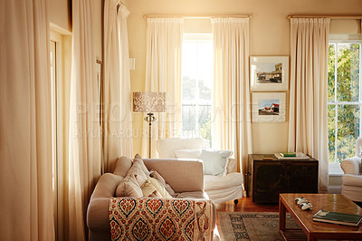 Buy stock photo Shot of a living room inside a residential home