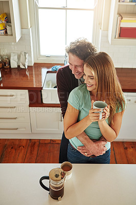 Buy stock photo Shot of an affectionate couple in the kitchen