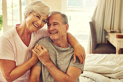 Buy stock photo Cropped shot of a senior couple embracing in their bedroom