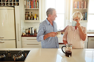 Buy stock photo Shot of a couple chatting over coffee at home