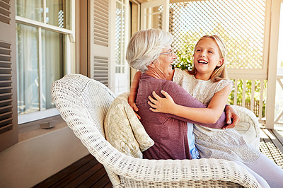 Buy stock photo Cropped shot of a young girl sitting outside with her grandmother