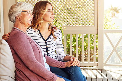 Buy stock photo Cropped shot of a senior woman sitting outside with her adult daughter