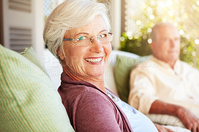 Buy stock photo Cropped portrait of a senior couple sitting outdoors