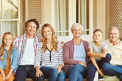 Buy stock photo Cropped portrait of a family of six sitting outside