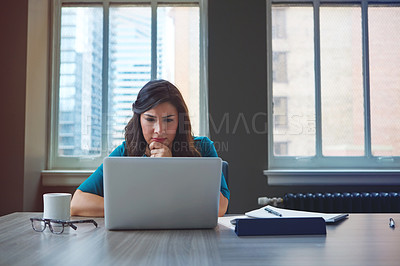 Buy stock photo Shot of a businesswoman using a laptop in an office