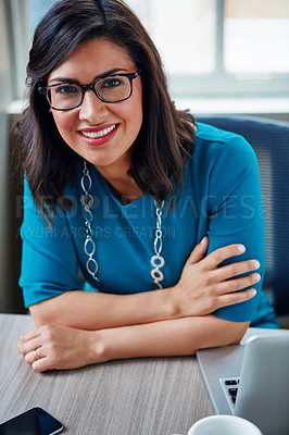 Buy stock photo Portrait of a businesswoman working at her desk in an office