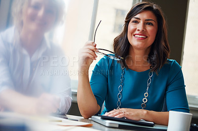 Buy stock photo Shot of two businesswomen having a meeting together in an office