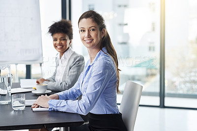 Buy stock photo Shot of two businesswomen seated at a table