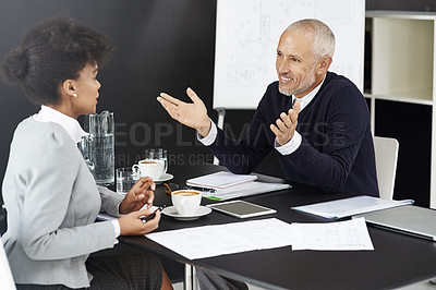 Buy stock photo Shot of a young businesswoman having a meeting with her boss