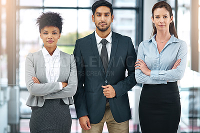 Buy stock photo Cropped shot of a team of businesspeople standing together