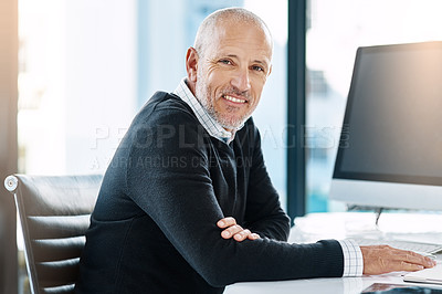 Buy stock photo Shot of a mature businessman in his office