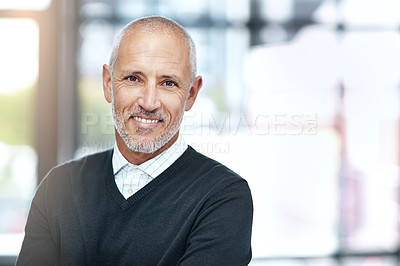 Buy stock photo Shot of a mature businessman at the office
