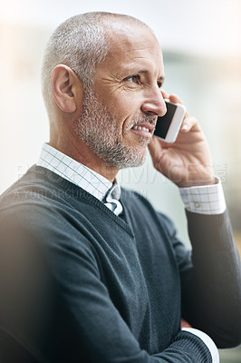 Buy stock photo Shot of a mature businessman taking a call at the office