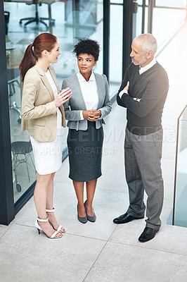 Buy stock photo Shot of a group of businesspeople having a discussion at work