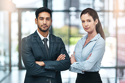 Buy stock photo Shot of two businesspeople standing side by side