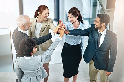 Buy stock photo Shot of a group of businesspeople giving a high-five