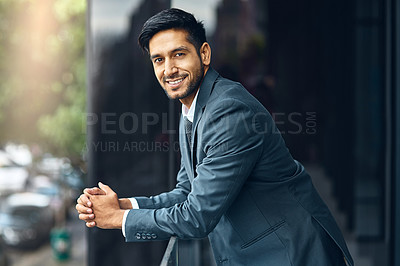 Buy stock photo Shot of a businessman standing   outside the office