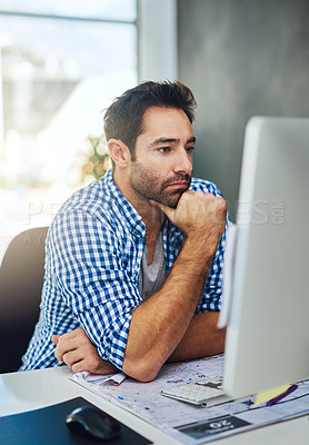 Buy stock photo Cropped shot of a businessman working on a computer in a modern office