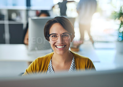 Buy stock photo Portrait of a smiling young businesswoman working in a modern office