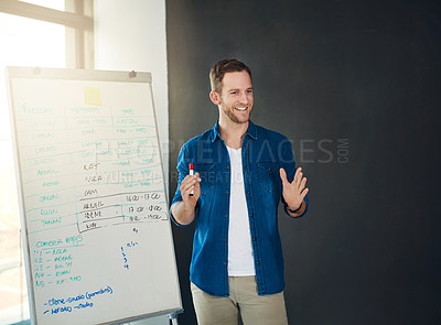 Buy stock photo Cropped shot of a young businessman giving a presentation in an office