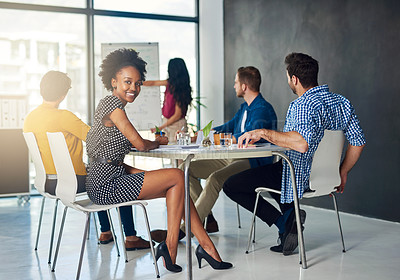 Buy stock photo Portrait of a young businesswoman in an office meeting with colleagues in the background