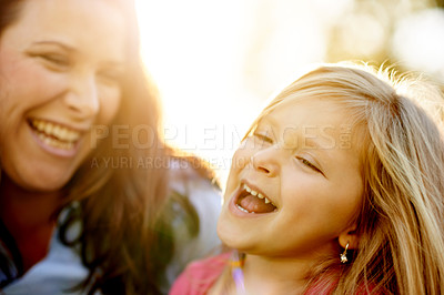 Buy stock photo Shot of a mother and her young daughter bonding at the park