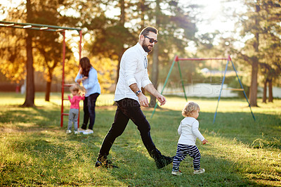 Buy stock photo Full length shot of a young family playing in the park