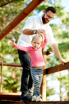 Buy stock photo Full length shot of a father and daughter on a jungle gym in the park