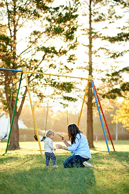 Buy stock photo Full length shot of a mother and daughter playing in the park