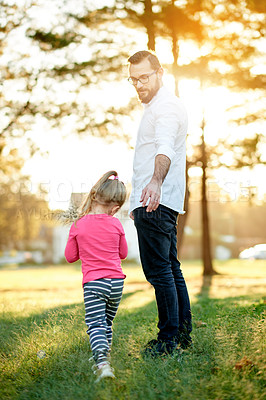 Buy stock photo Shot of a father spending time with his young daughter at the park