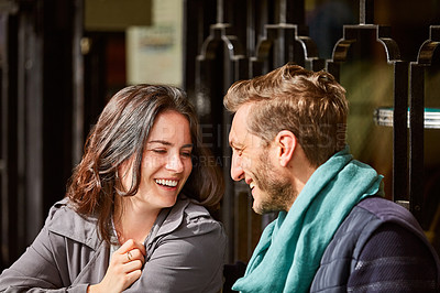 Buy stock photo Shot of a smiling couple sitting together at a table at a sidewalk cafe