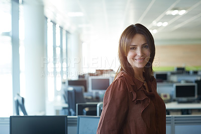 Buy stock photo Portrait of a young woman standing in her office