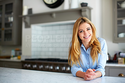 Buy stock photo Portrait of a young woman leaning on her kitchen counter at home