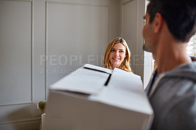 Buy stock photo Cropped shot of a young couple moving in to their new house