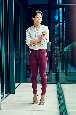 Buy stock photo Shot of a young businesswoman having a coffee break at work