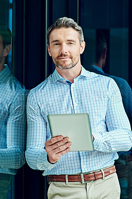 Buy stock photo Portrait of a businessman using a digital tablet at work