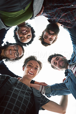 Buy stock photo Cropped shot of a group of creative businesspeople in a huddle