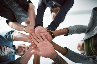 Buy stock photo Cropped shot of a group of people stacking their hands on top of each other