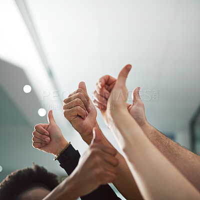 Buy stock photo Cropped shot of various people's hands showing thumbs up