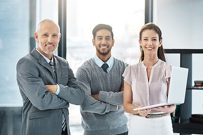 Buy stock photo Cropped portrait of three businesspeople standing in the office