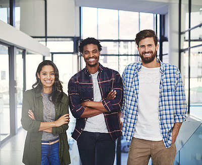 Buy stock photo Portrait of three young designers standing together in a modern office