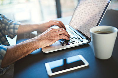 Buy stock photo Closeup shot of a young creative working on a laptop in a modern office