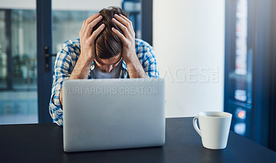 Buy stock photo Cropped shot of a stressed out young designer sitting with a laptop in a modern office