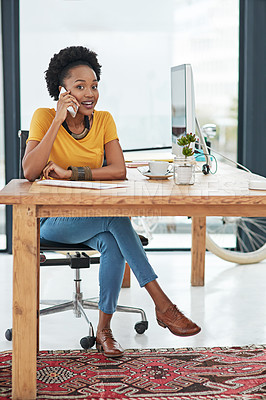 Buy stock photo Full length portrait of a young designer talking on her cellphone in her office