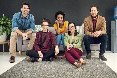Buy stock photo Portrait of a group of young creatives sitting together in an office