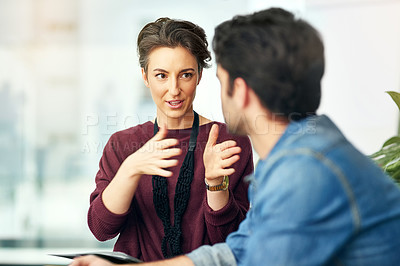 Buy stock photo Cropped shot of young creatives having a discussion in a modern office