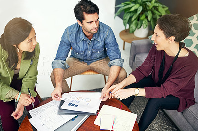 Buy stock photo Cropped shot of young creatives having a meeting in a modern office