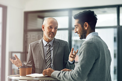 Buy stock photo Cropped shot of two businessmen talking in their office